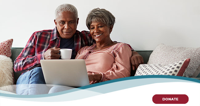 African american family in living room on laptop